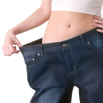 Close-up of female figure with jeans of big size on